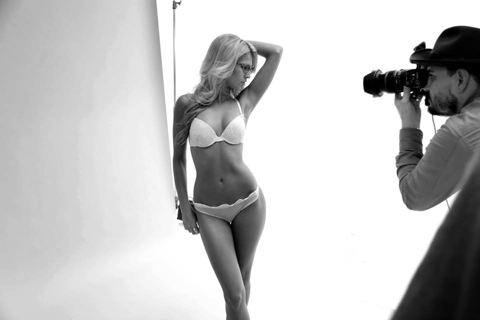 lingerie model being photographed in studio
