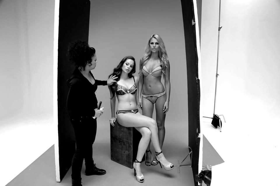 lingerie models and stylist on paper backdrop for photographic shoot