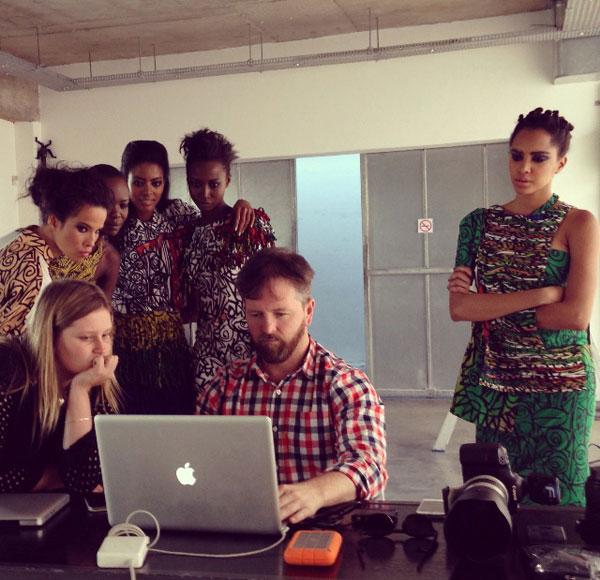Justin Polkey and models looking at photographs